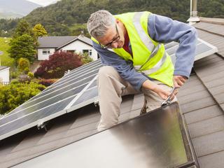 man adding solar