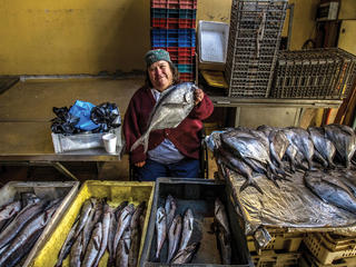 Chilean fisherwoman with fish