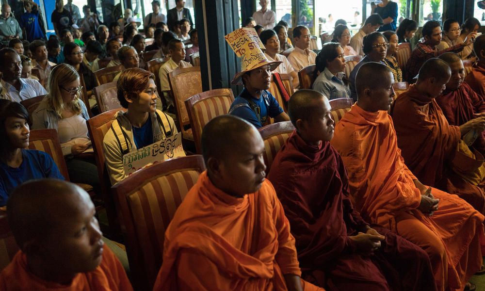 monks sit in protest