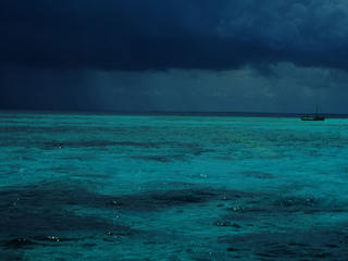 Thunderstorms can come up suddenly on the outlying reefs Tutia Reef, Tanzania
