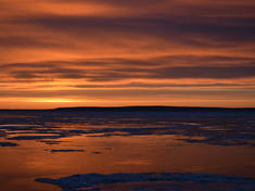 Sun rising over bristol bay c laura margison