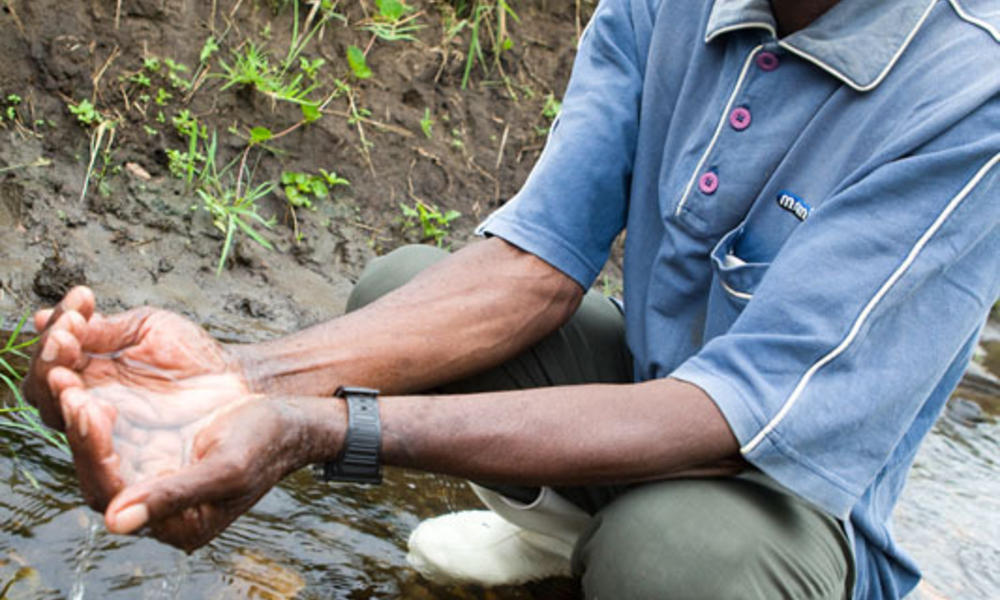 checking the quality of the water, Rwenzori Mountains, Uganda