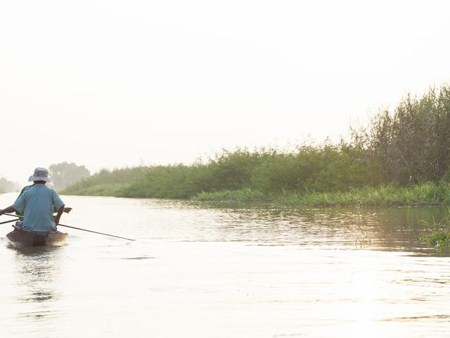Fishermen Tran Van Cu and Pham Huu Tri on the Mekong