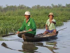 Fishermen Tran Van Cu and Pham Huu Tri on the Mekong