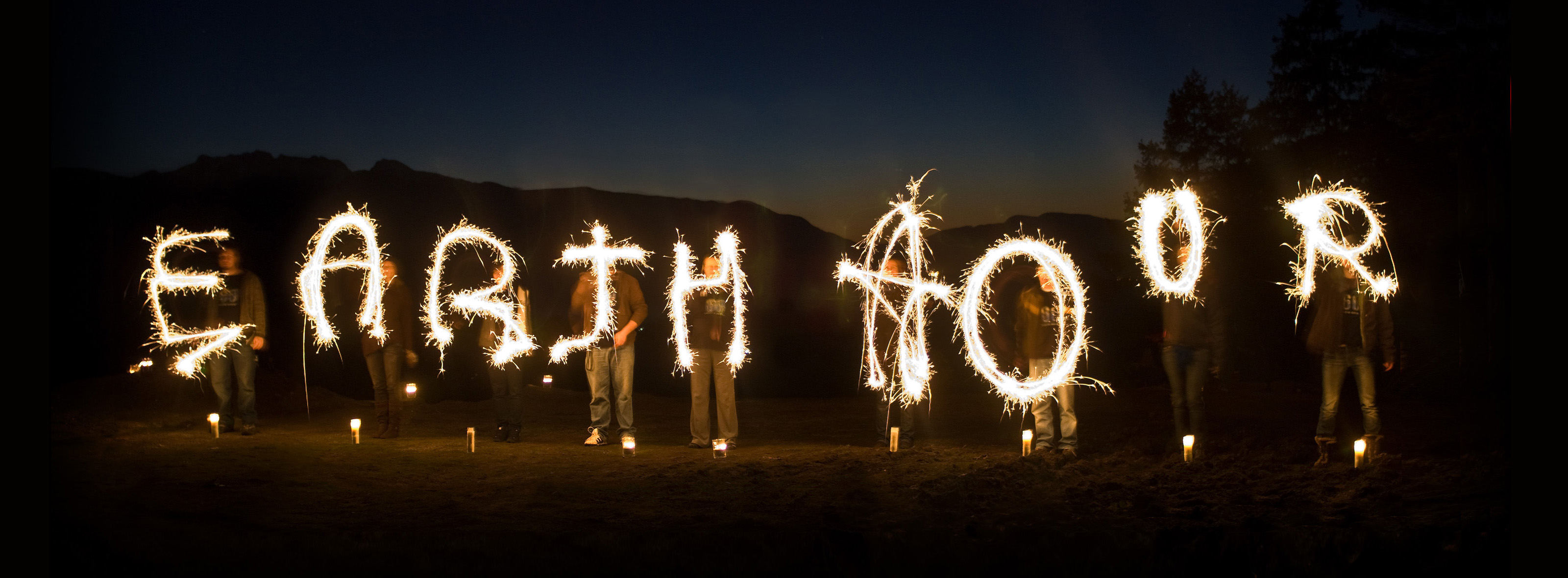 Participants spell 'Earth Hour' with sparklers