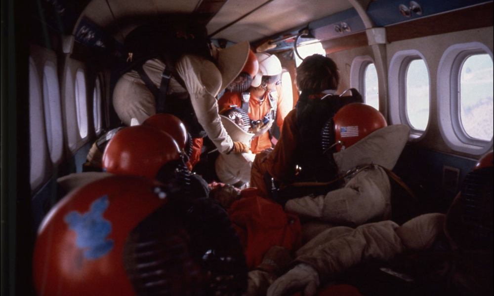 smoke jumpers preparing to parachute down