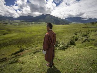 Tashi Dorji stands in Bhutan's Phobjikha Valley