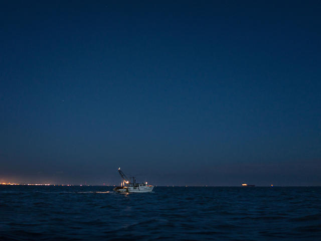 Shrimpers work the waters off the Texas coast